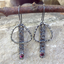 "Load image into Gallery viewer, These handmade earrings are patinated to emphasize the hand texturing created on Sterling Silver and Argentium™ metals.  A 3mm, bezel-set Pink Tourmaline is the finishing touch.  20 gauge Argentium™ ear wires  Total Length:  2"" from the top of the ear wires to the bottom of the charm.  Charm size:    1 3/8"" long x 3/4"" wide  Pink Tourmaline can help with understanding love."