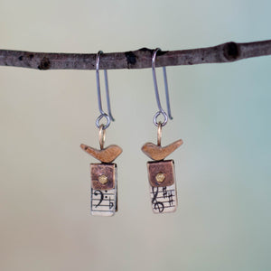 Perched atop a tiny book made from discarded hymnals, micro screws and Scrappy Treasures*, these handmade earrings feature tiny birds singing their songs of praise just for you!
