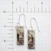 Load image into Gallery viewer, I do believe there's a man in my martini!  That certainly makes it a gin kind of day! These handmade earrings are created from a Hendrix gin label and found object metal these earrings are filled with whimsy and fun.  They are sealed with resin.