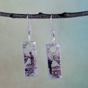 I do believe there's a man in my martini!  That certainly makes it a gin kind of day! These handmade earrings are created from a Hendrix gin label and found object metal these earrings are filled with whimsy and fun.  They are sealed with resin.