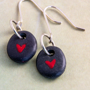 It's always a welcome surprise when two stones that are similar enough to become earrings! This can take a lot of rock hounding and sorting but it is always worth it! This pair asked for a tiny red heart to be painted on each of them. Let them whisper their secrets of love in your ears...only for you to hear.