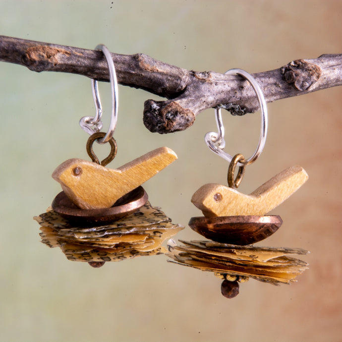 A penny for the thoughts of the mama birds as they sit in their nests of these handmade earrings.   Perhaps they are thinking of love, hope and joy which is symbolized by their White Topaz eyes.