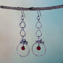 Load image into Gallery viewer, Sometimes action can take a lot of courage!  As they whisper in your ears, these handmade earrings featuring 6mm Carnelian gemstones are offering you the courage to make that choice.  Textured and patinated Sterling Silver and Argentium™ .