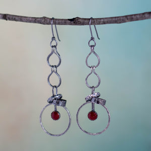Sometimes action can take a lot of courage!  As they whisper in your ears, these handmade earrings featuring 6mm Carnelian gemstones are offering you the courage to make that choice.  Textured and patinated Sterling Silver and Argentium™ .