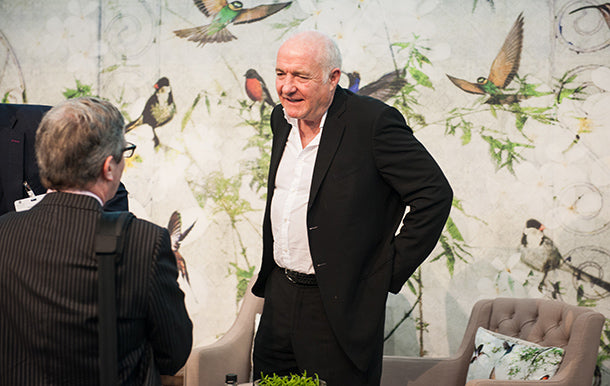 Rick Stein in front of Birds Mural Design by ATADesigns
