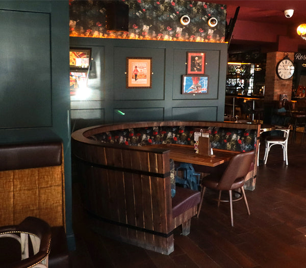Dog N Watch Fabric and wallpaper Design by ATADesigns and Arka Chergui upholstered onto banquet seatings at The Priory in Tynemouth