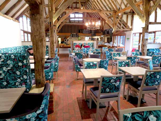 Kews Leafy Florals Fabric Design by ATADesigns Upholstered by Hillswood Furnitur Group on to fixed seatings and chairs at The Old Barn at Tates Garden Centre