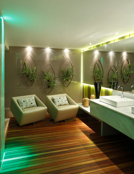 Ladies Powder Room Featuring Squiggle tiles and cushions design by ATADesigns