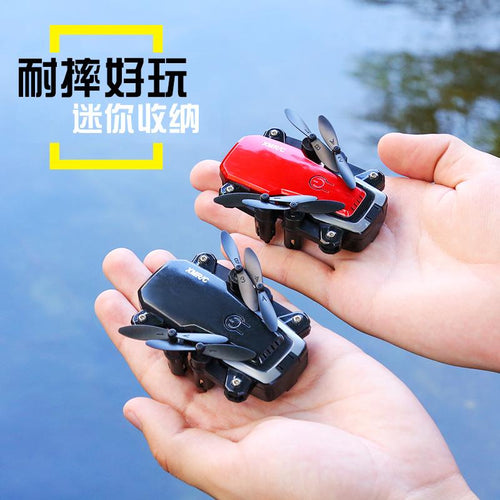 Cross-border e-commerce mini folding drone HD aerial photography four-axis aircraft toy helicopter remote control aircraft