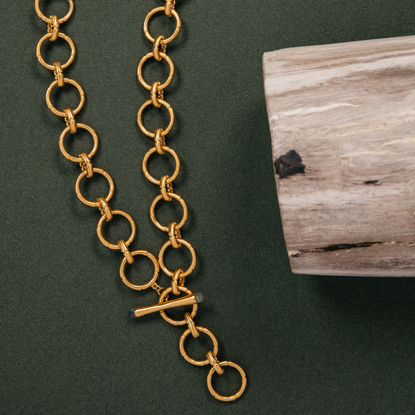 "Bamboo Link Chain Necklace - Big Bag Dean Davidson Bamboo Link Chain Necklace  With statement-making links drawing inspiration from the organic, curved lines of the bamboo tree, the Bamboo Link Charm Necklace comes together with a custom gemstone embellished toggle clasp. Matching bracelet available  22KT Gold over brass  Rhodium over brass  Hypoallergenic posts  Width: 2.1cm / 0.8"" Length: 55cm / 22"""