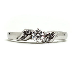 Solitaire diamond ring with intricate diamond set shoulders