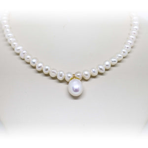 White freshwater pearl strand with pearl drop
