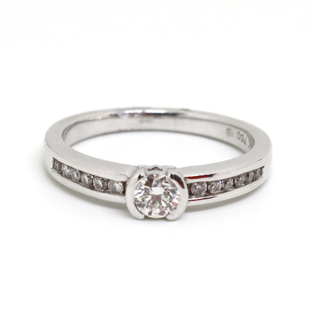 Half rub over brilliant cut diamond ring with diamond channel set shoulders