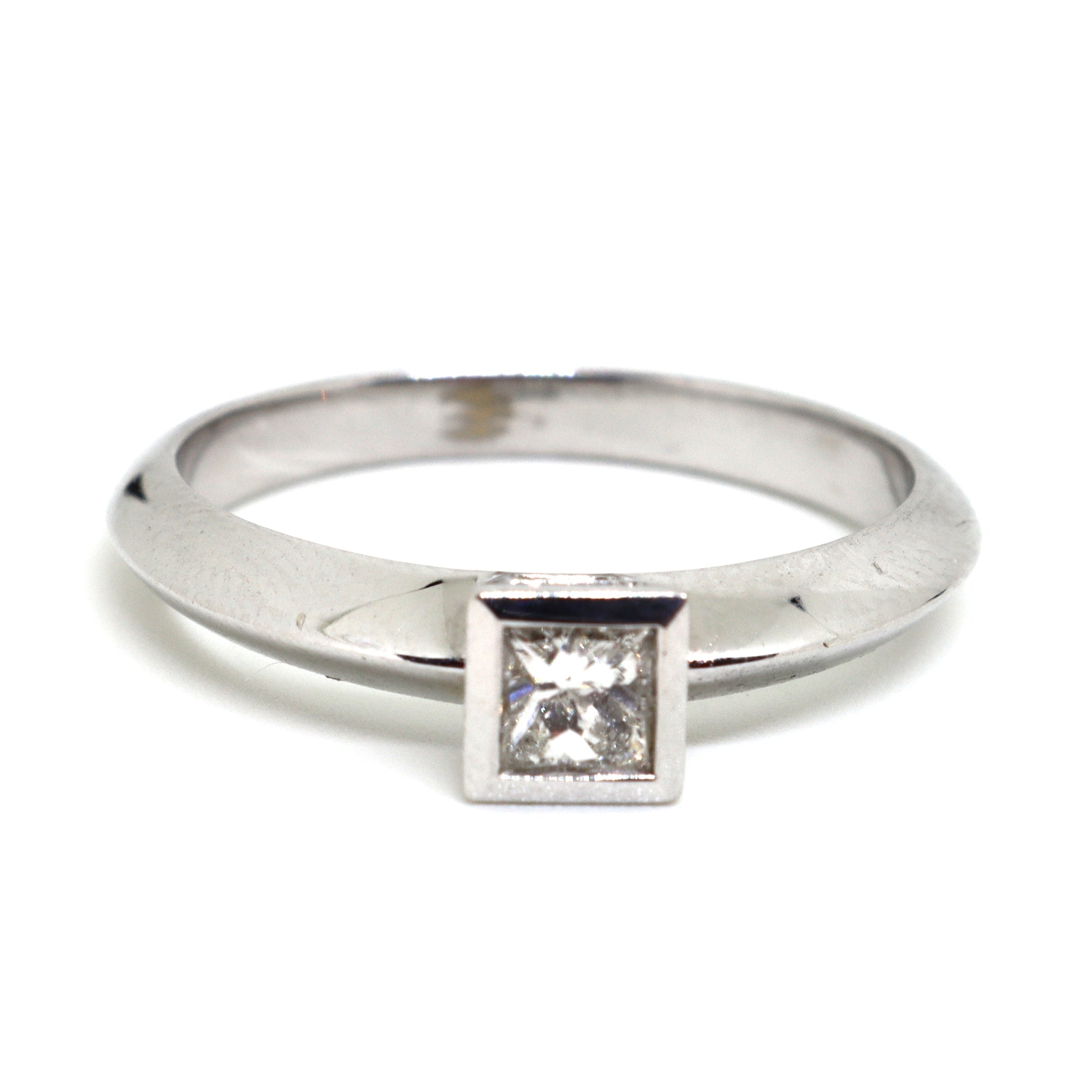 Solitaire ring with a princess cut diamond