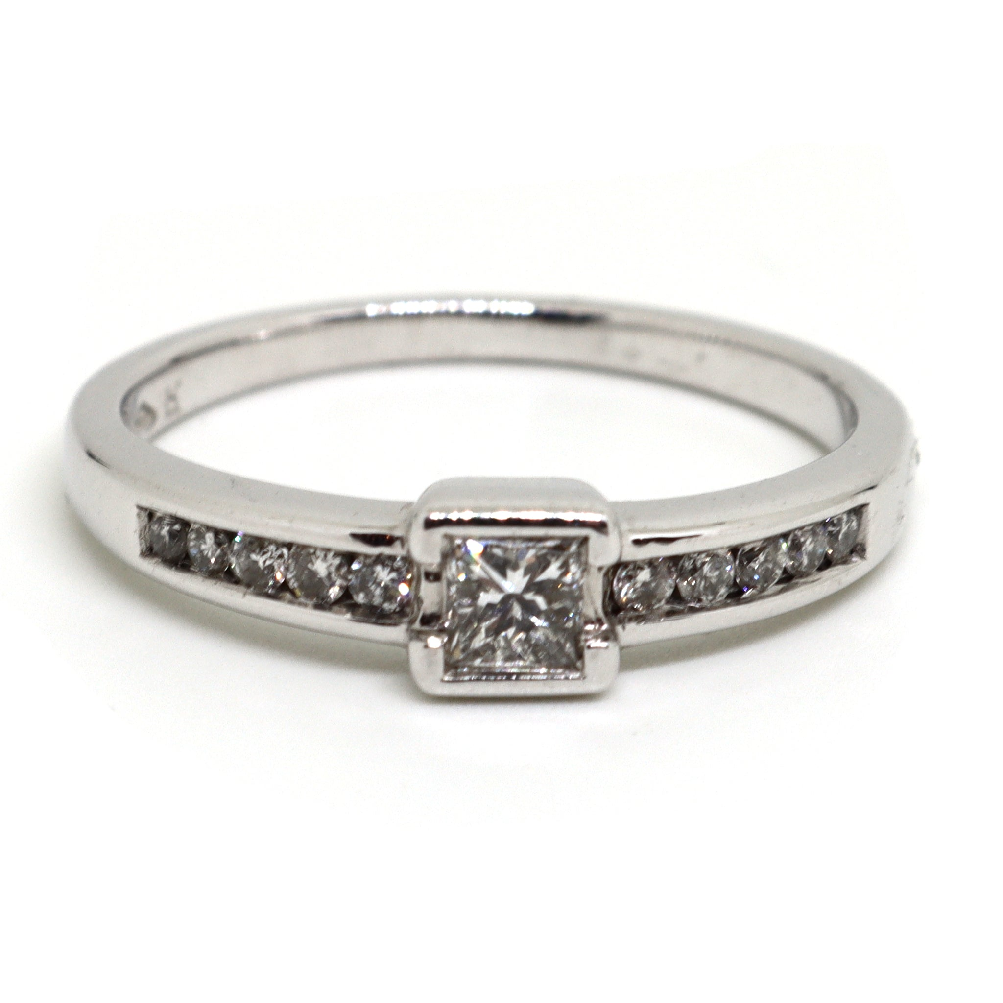 Princess cut diamond with diamond channel set shoulders