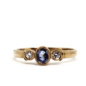 Yellow gold rub over sapphire and diamond ring