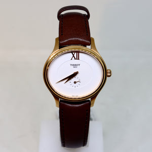 Tissot white face and gold surround womens watch