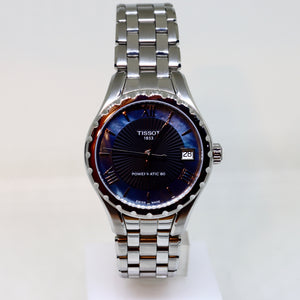 Tissot white face and navy surround womens watch