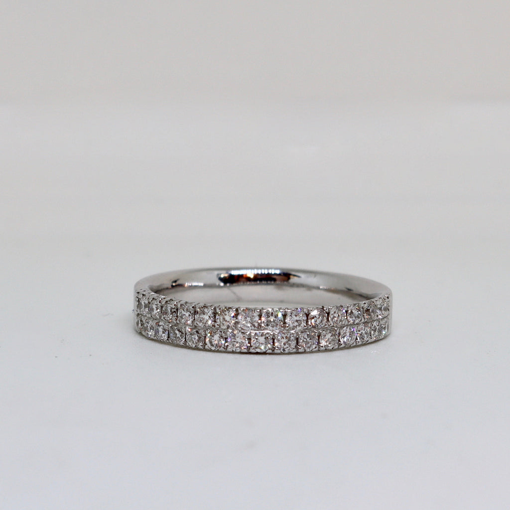 Double diamond channel set ring