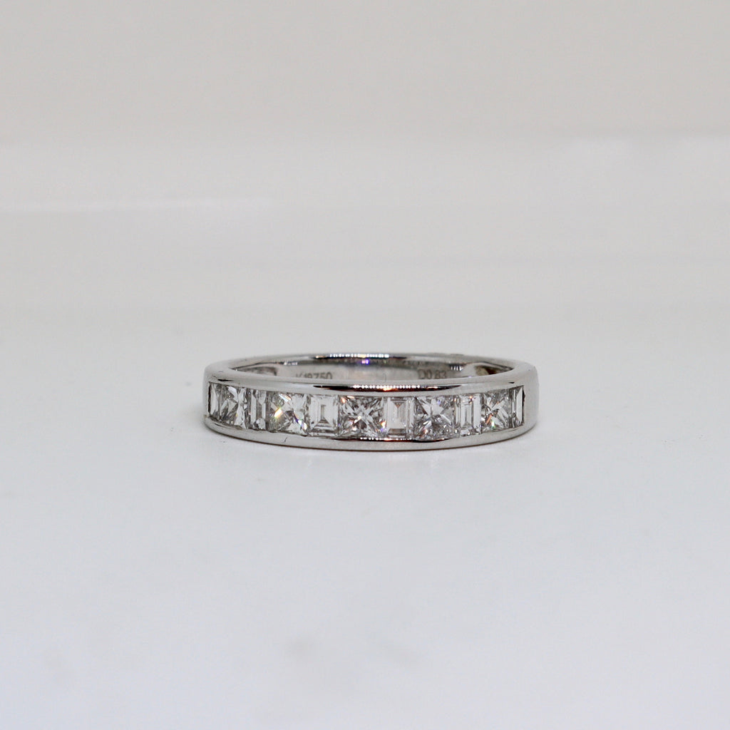 Diamond channel set eternity band