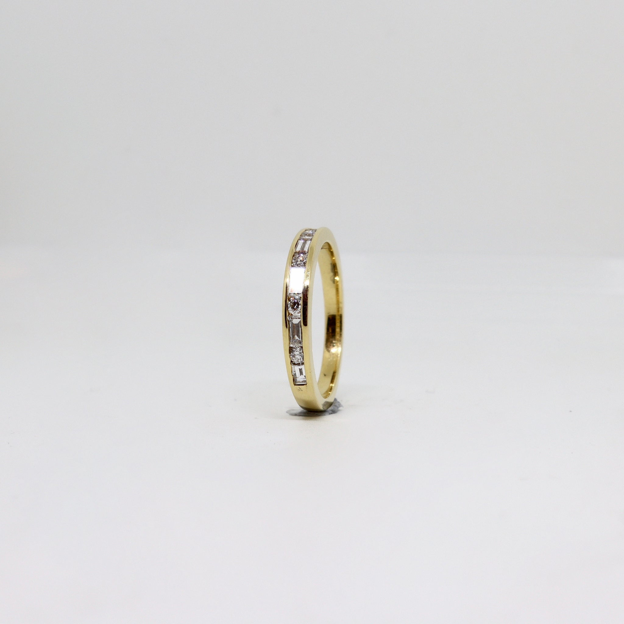Baguette and Round Diamond channel set ring