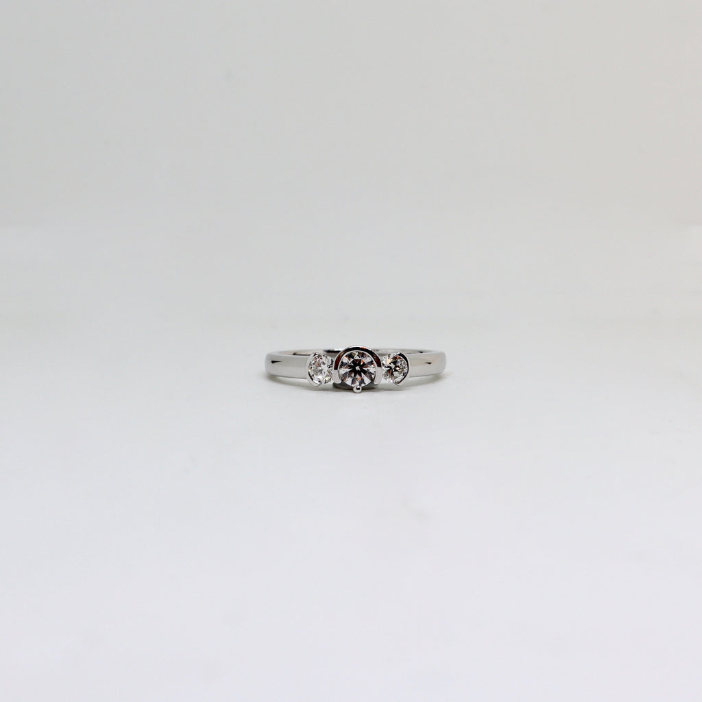 3 stone diamond half rub over ring