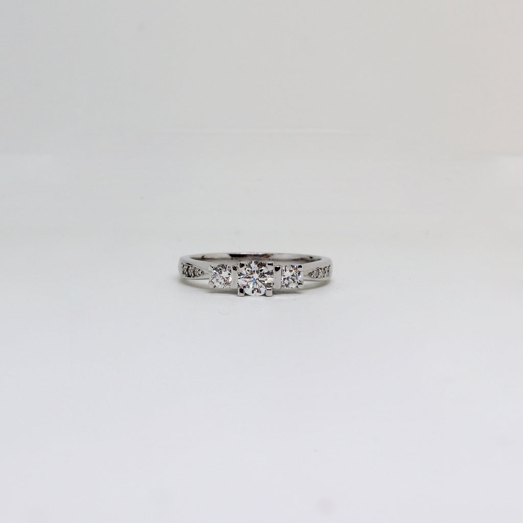 3 stone diamond claw set ring with diamond bead set shoulders