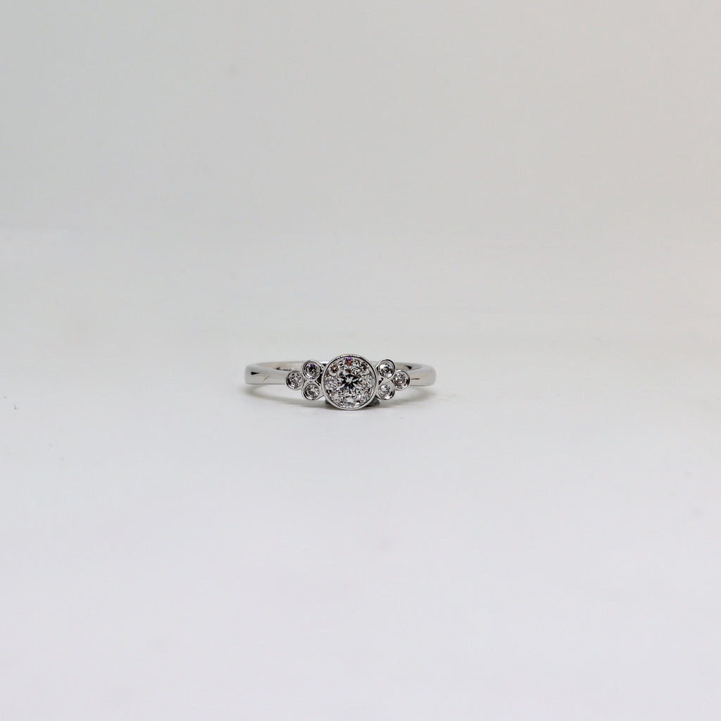 Multi stone diamond rub over ring