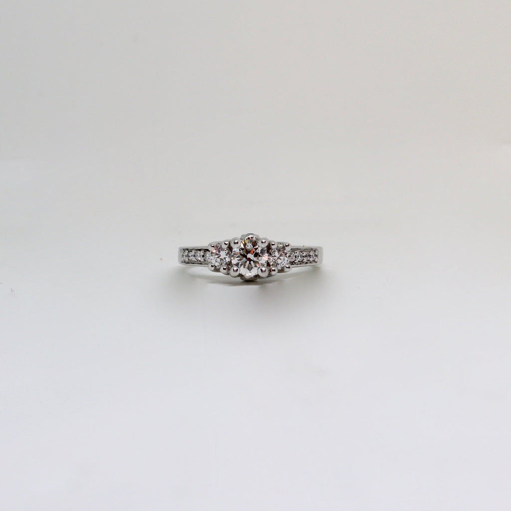 3 stone diamond claw set ring with diamond grain set shoulders