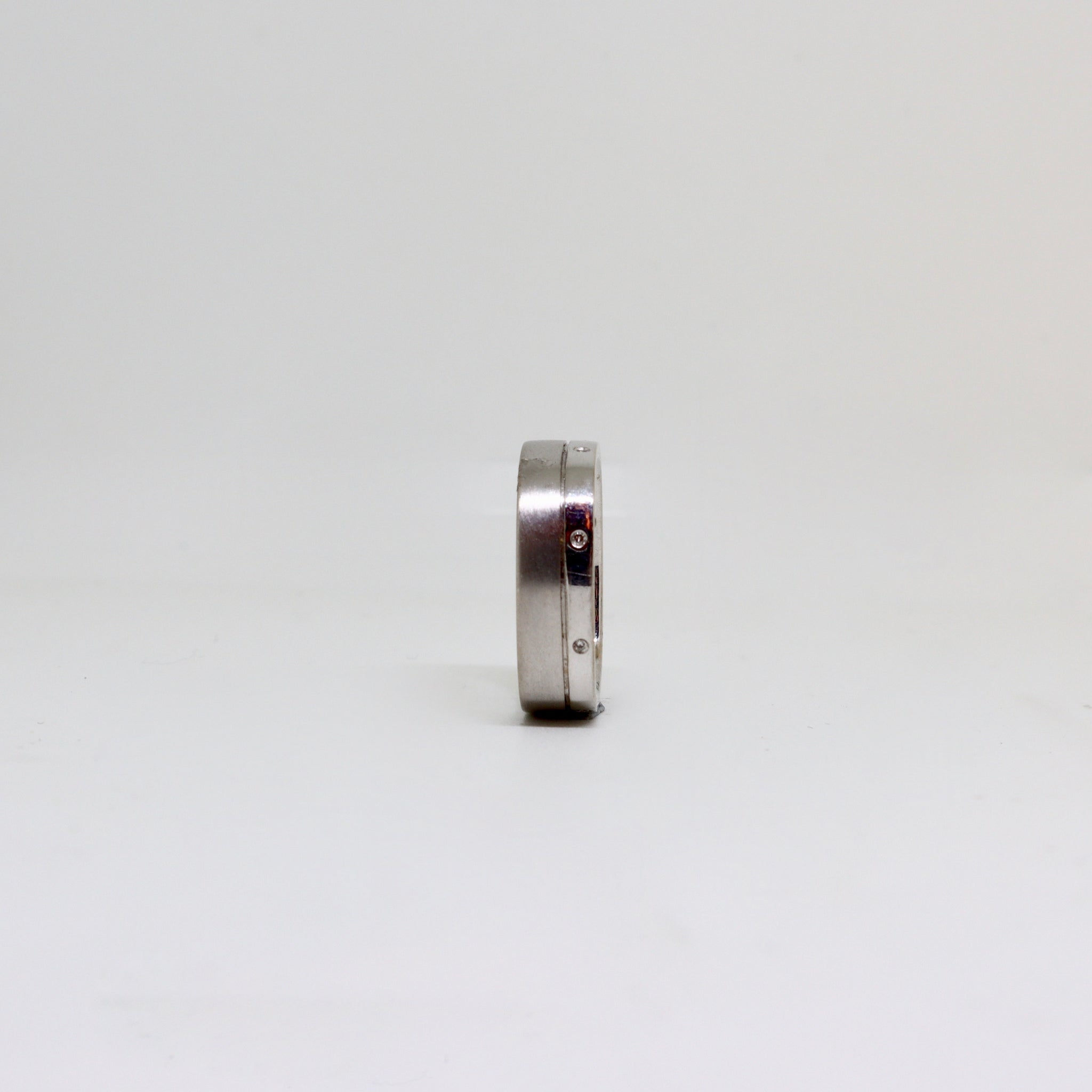 White gold square brushed and polished ring with diamonds