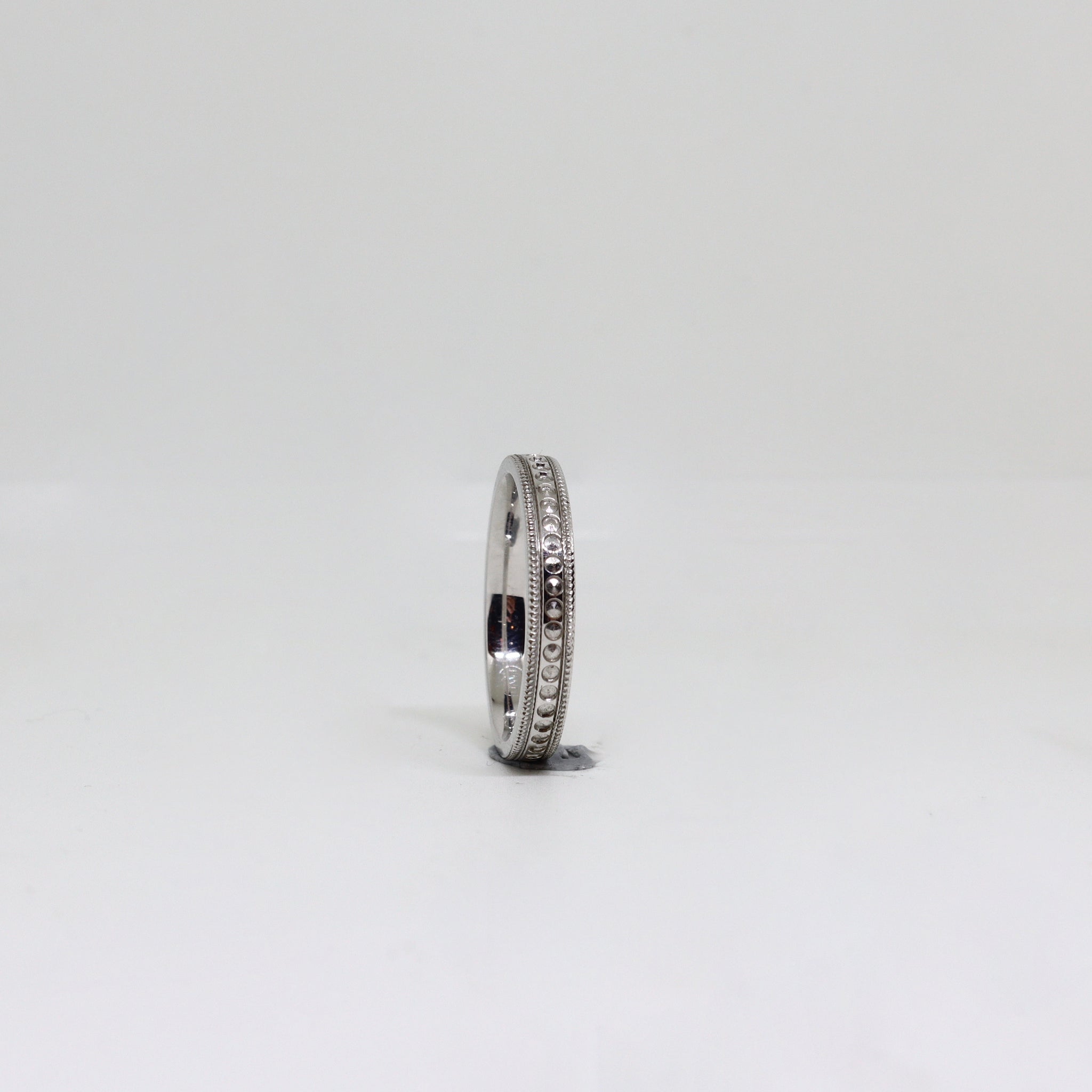 White gold millgrain womens ring with engraved center