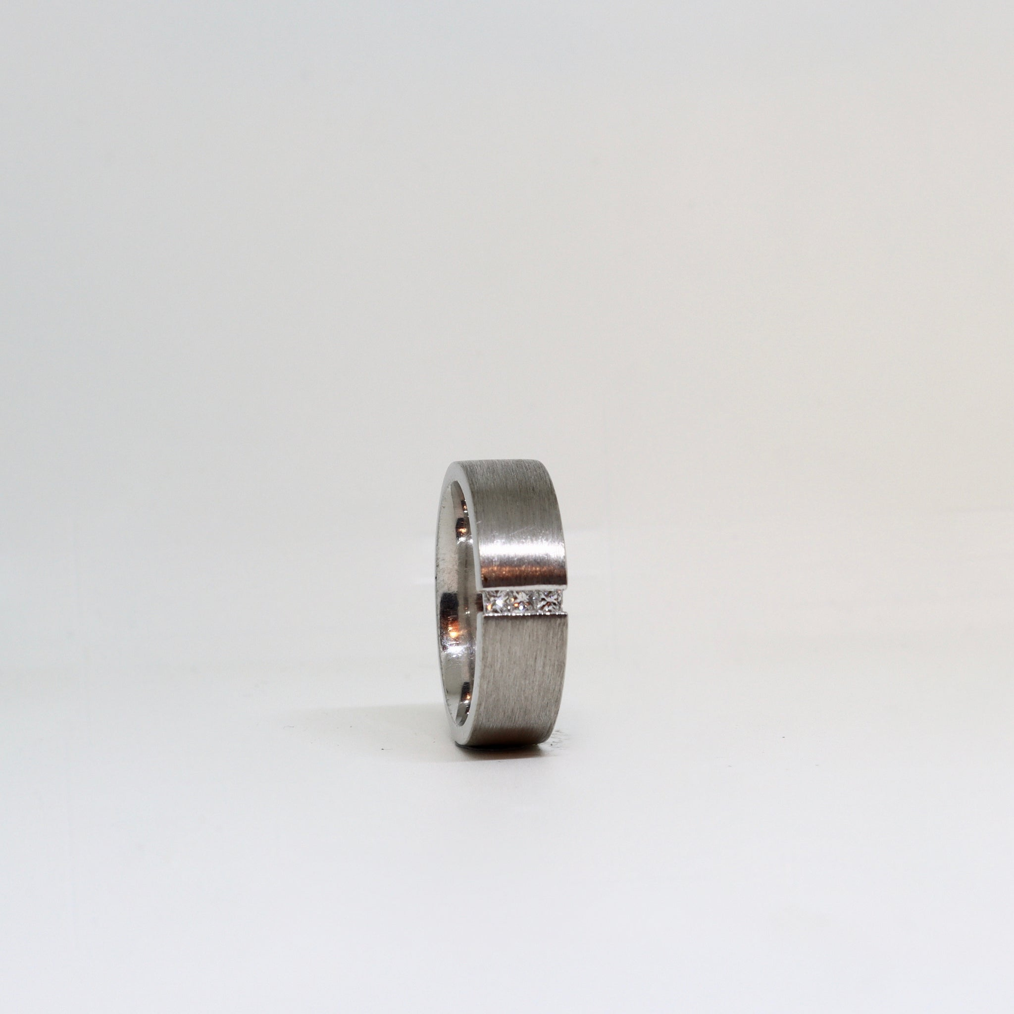 Brushed white gold brushed finish with channel set diamonds mens ring