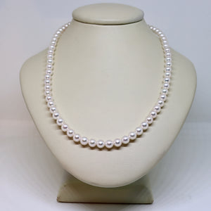 Small round pink/white pearl strand