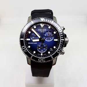 Tissot navy face and black surround mens watch