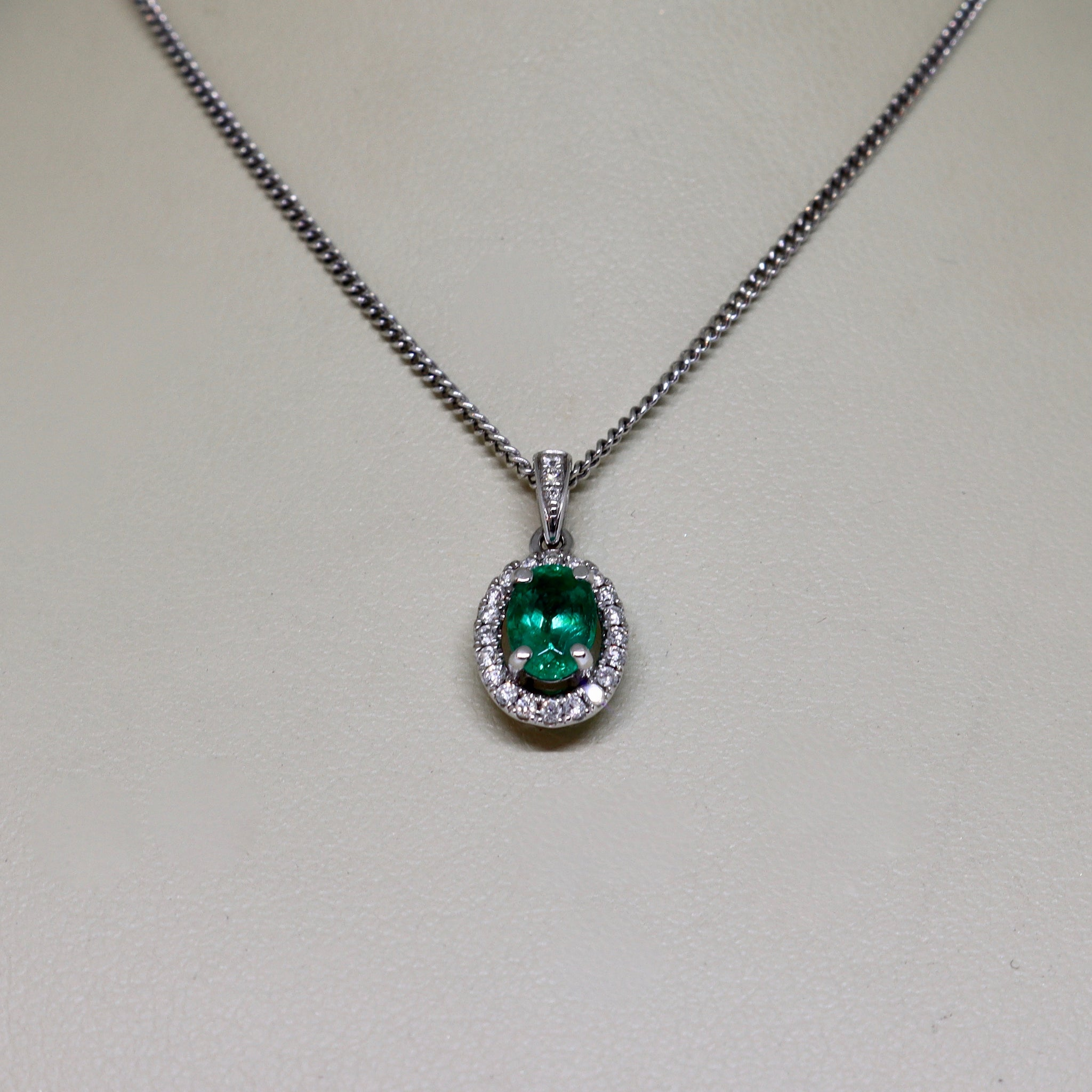 Emerald and diamond pendant necklace