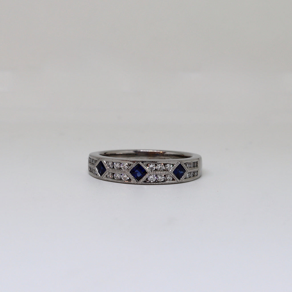 Sapphire and diamond channel set dress ring