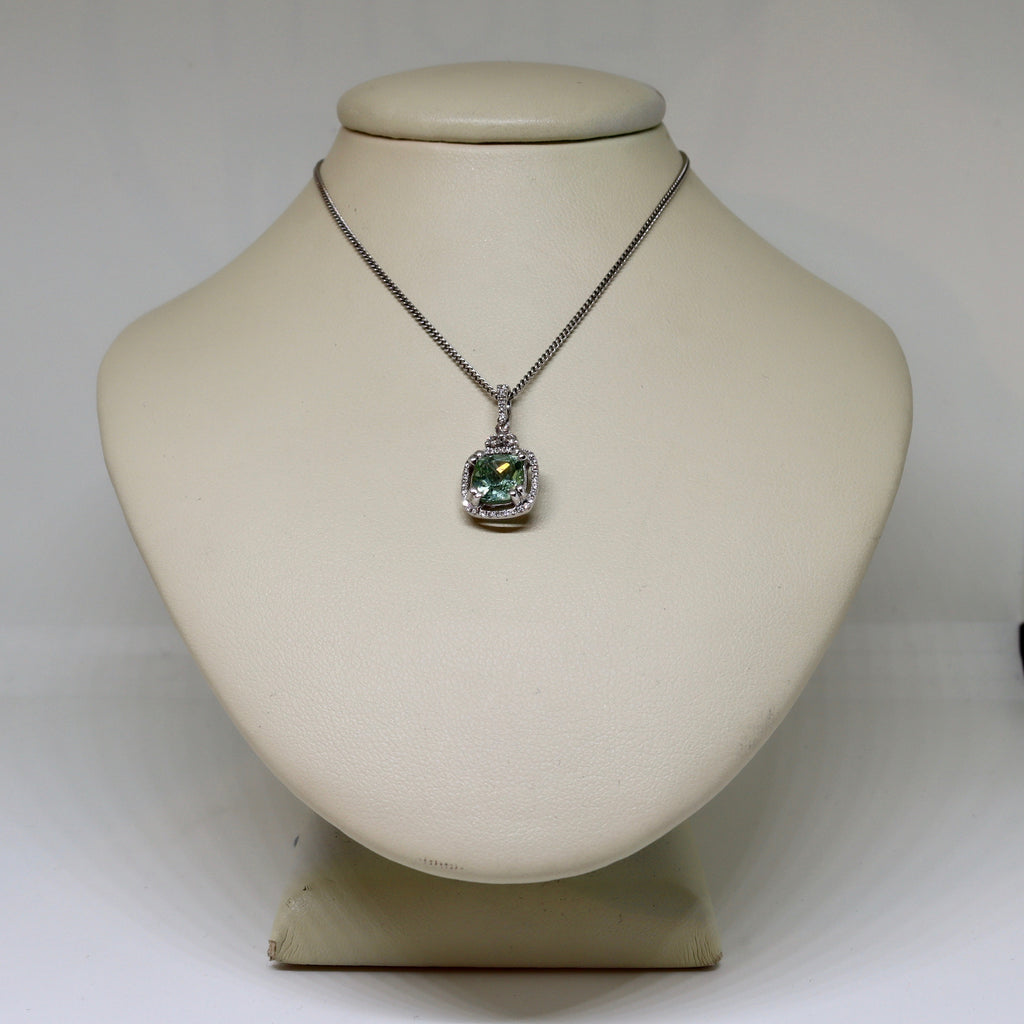 Tourmaline and diamond halo set pendant