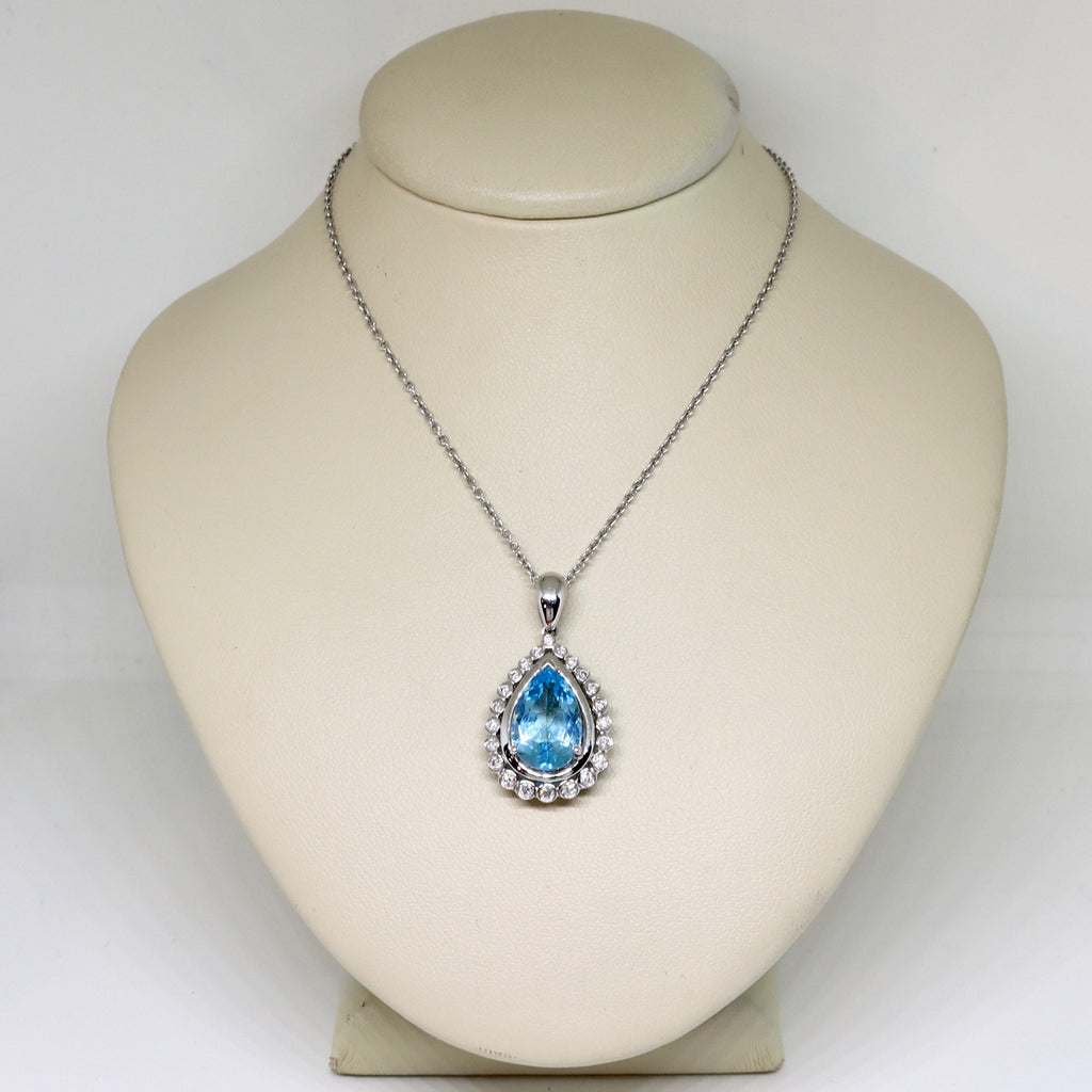 Aquamarine and diamond halo drop pendant