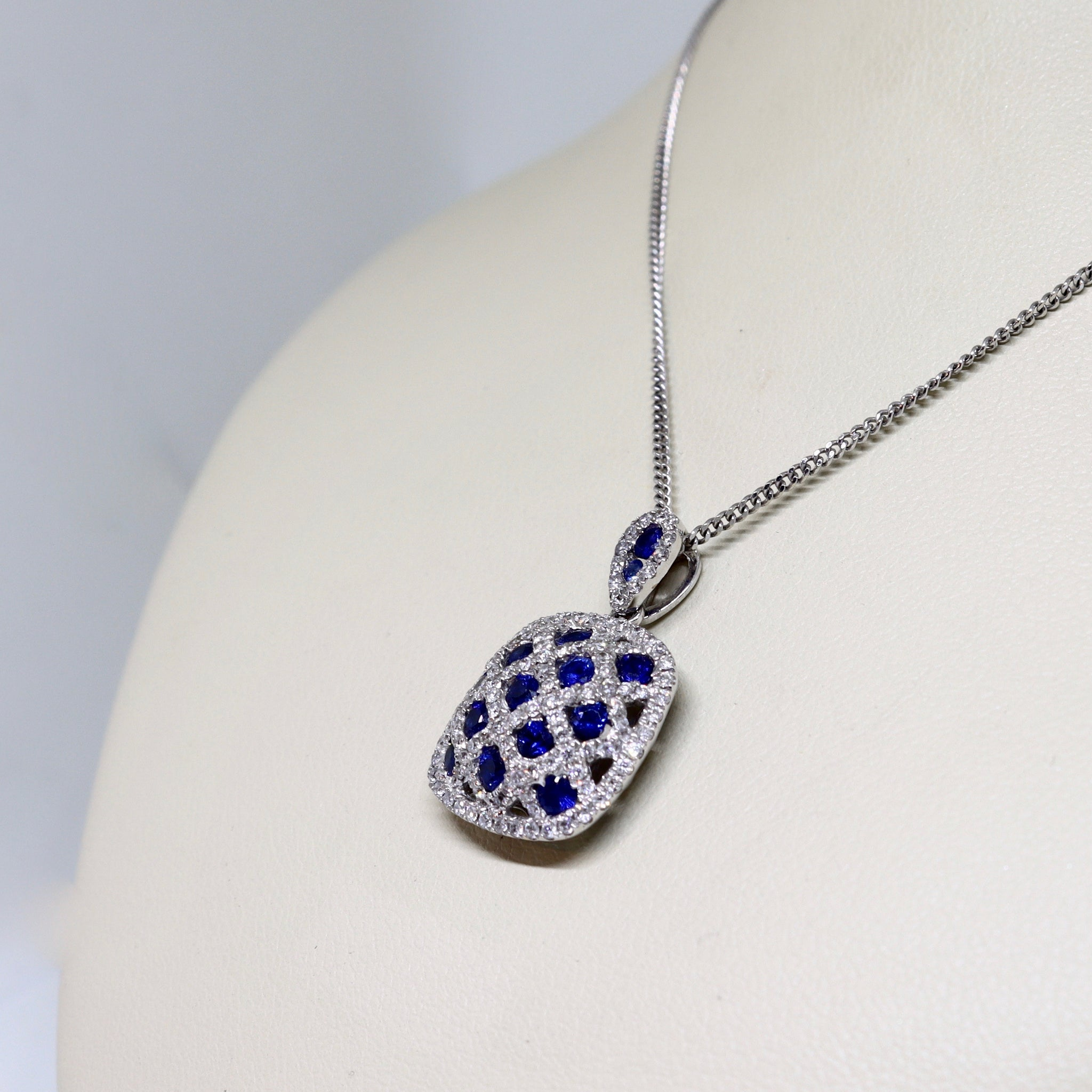 Sapphire and diamond pavé set crossover pendant