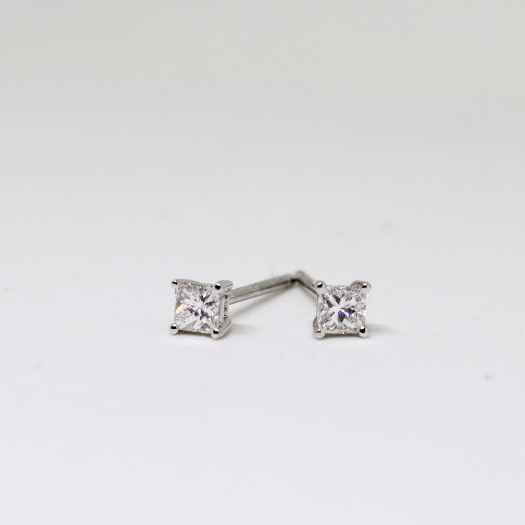 Claw set diamond stud earrings