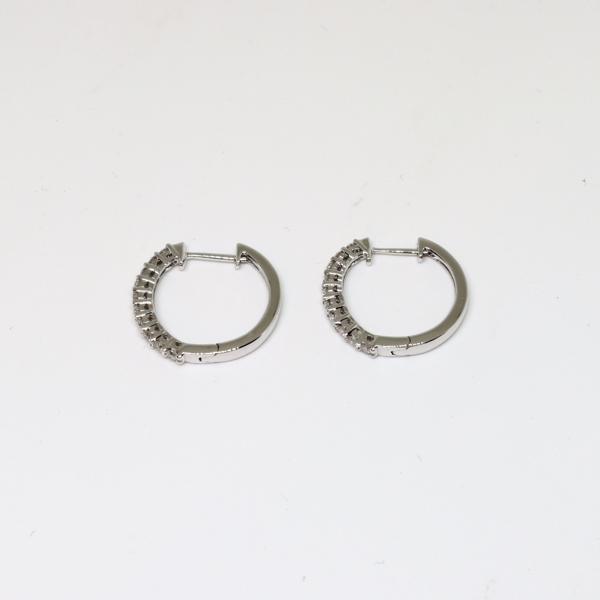 white gold and diamond claw set hoop earrings