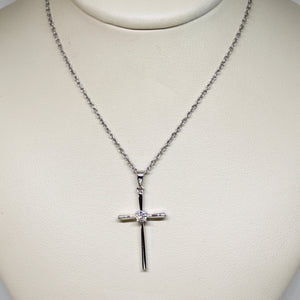 White gold cross with diamond center