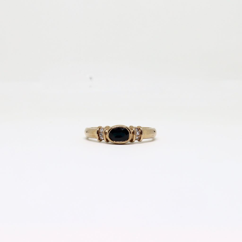 Sapphire and diamond rubover ring