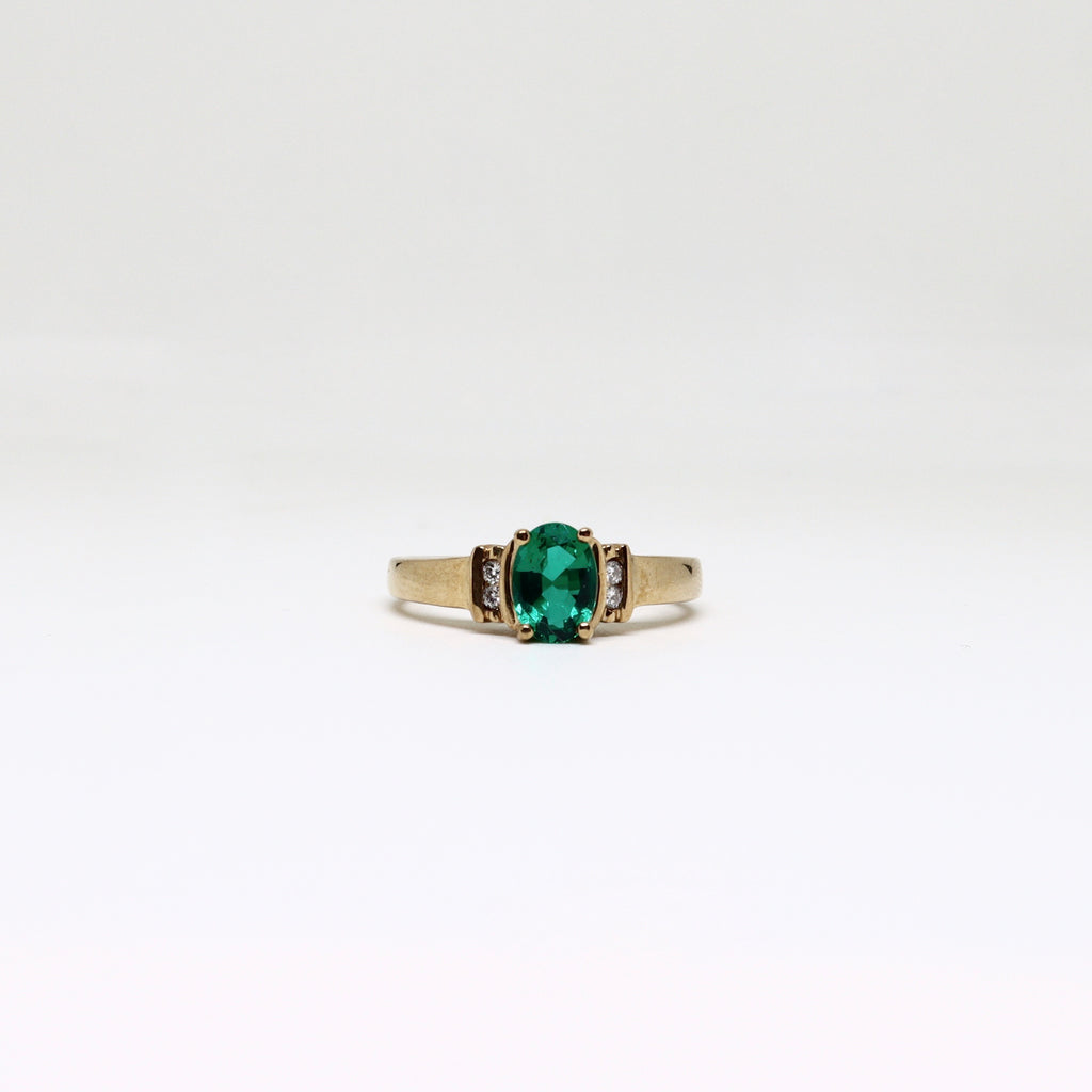 four claw biron emerald and diamond ring