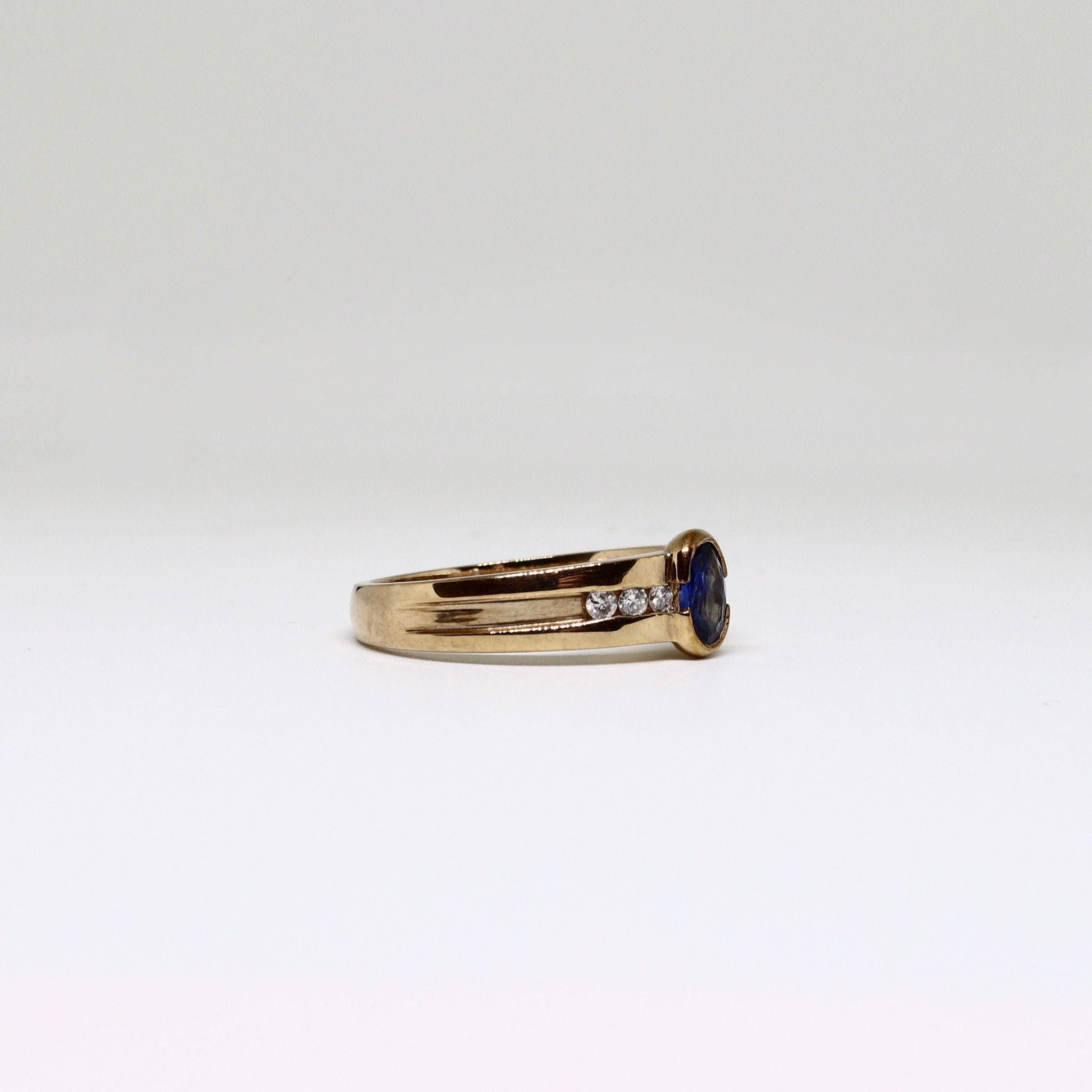 Sapphire dress ring with diamond channel set shoulders