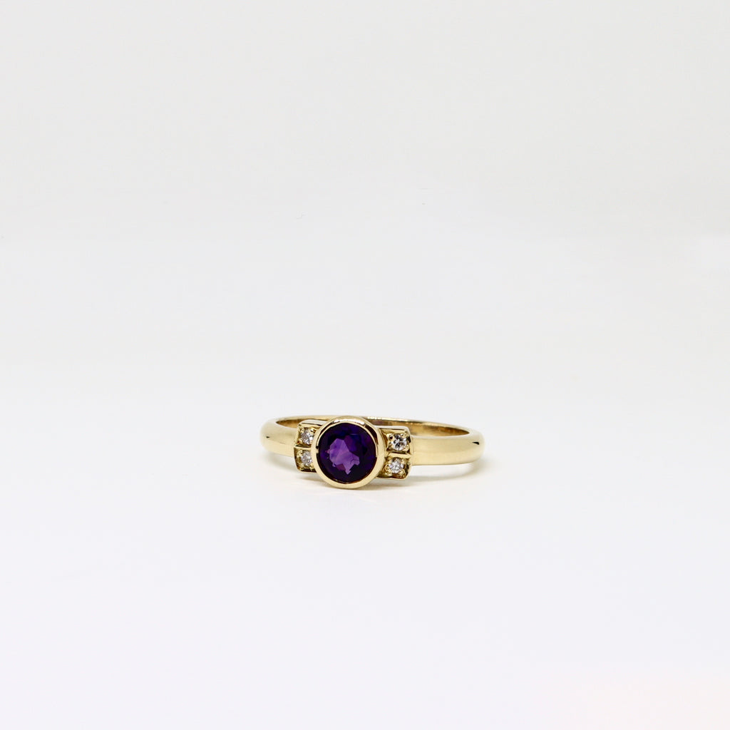 Amethyst and diamond rub over ring