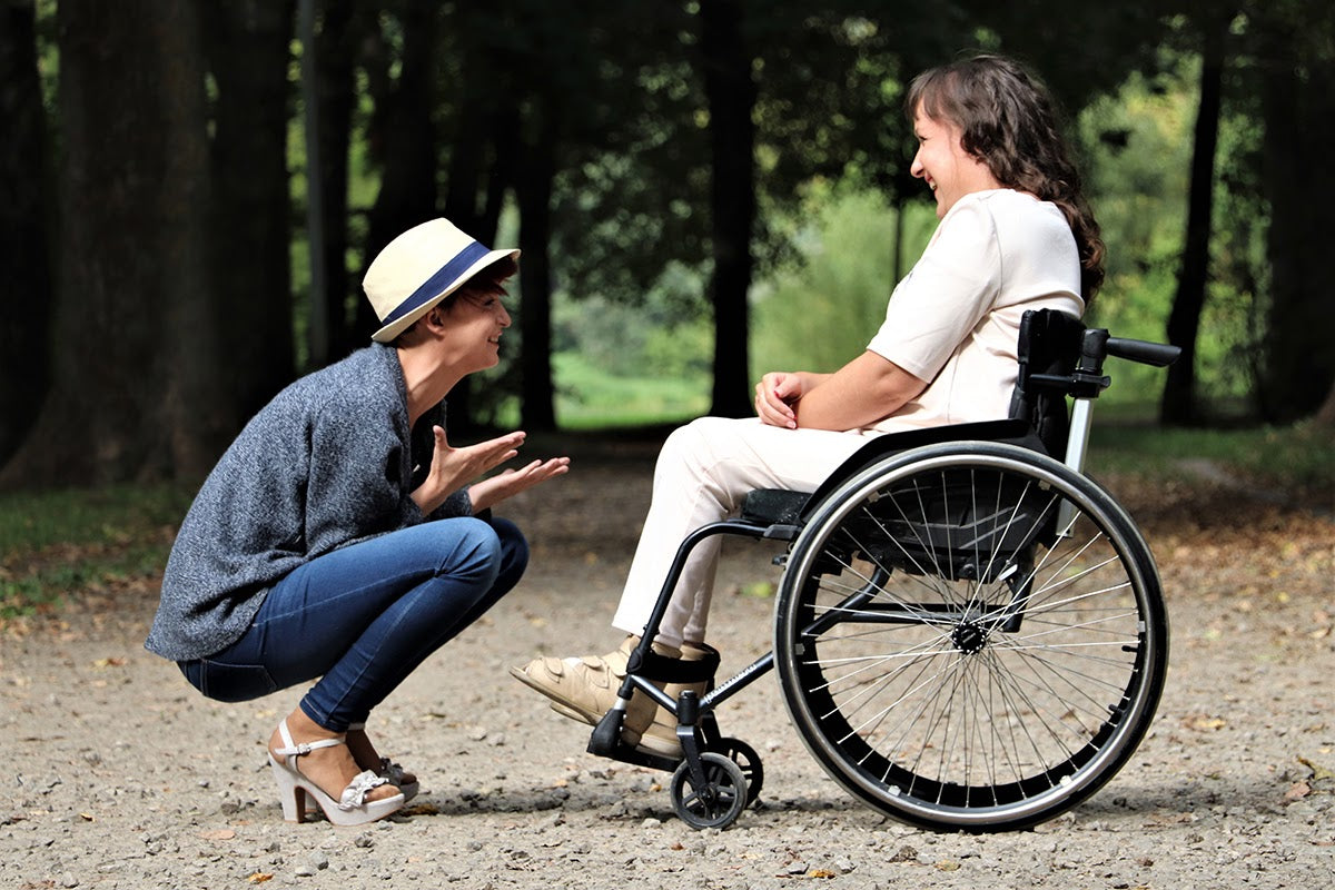 Friends-disabled-laughing-park-wheelchair