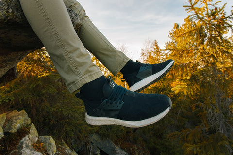 Man-breathable-sneakers-hiking-rocks-forest