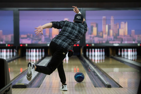 Playing bowling with black shirt