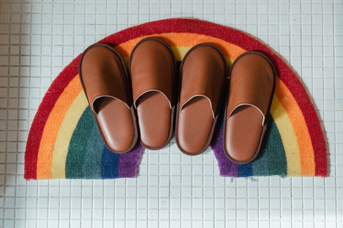 Shoes on rainbow mat